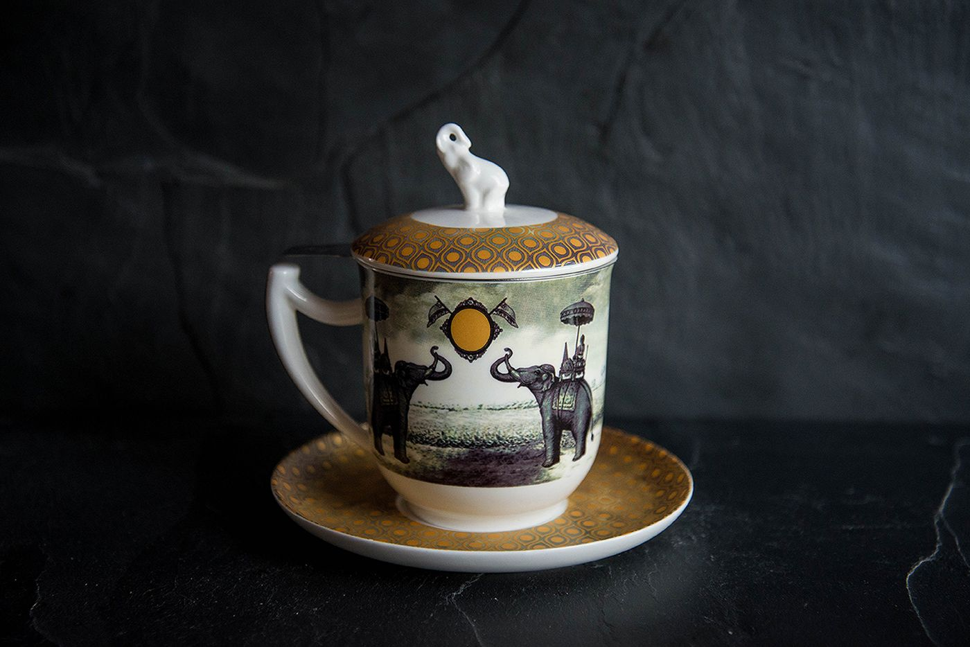 Sepia Elephant Infuser Cup and Saucer